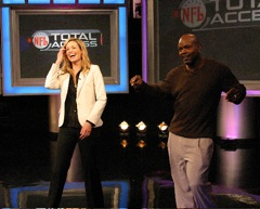 Emmitt Smith shows Alex Flanagan some of his dancing moves.