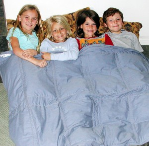 girls in blanket 300x294 Autism vs. Aspergers Syndrome: Signs Your Child Might Have Either and Why Jenny McCarthy Upsets the Autistic Community