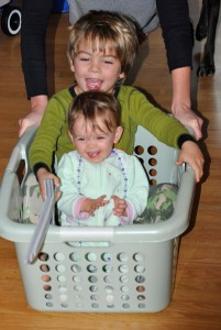 Who needs toys when a laundry basket works just as well?