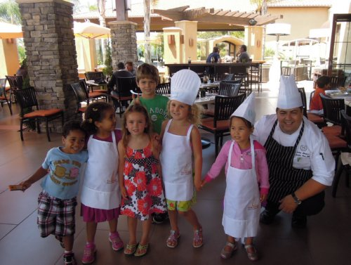 "A few of the kid ""taste testers"" with TWENTY/20 Executive Sous Chef, Andres Hinojosa"